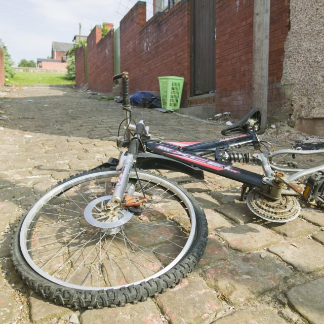 """A bike abandoned in a Pakistani area of blackburn UK"" stock image"