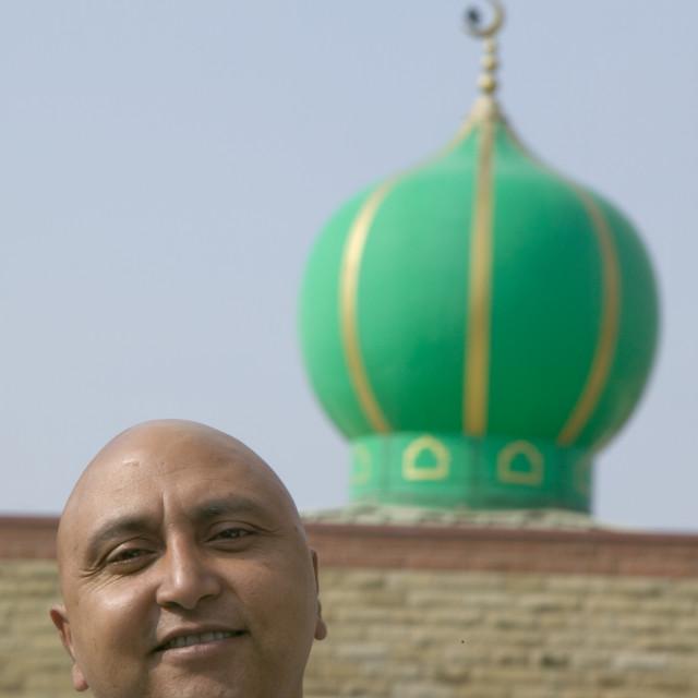 """A muslim man in a Pakistani area of Blackburn UK"" stock image"