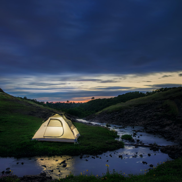 """Campsite By a Stream in the Evening"" stock image"