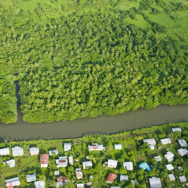 """Deforestation of Rainforest round a village on Fiji"" stock image"