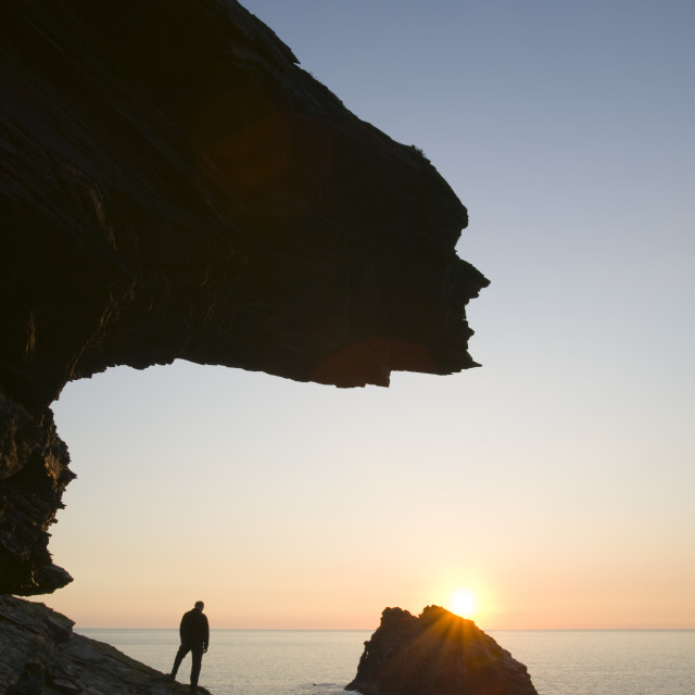 """""""A man on the cliff tops at Boscastle overlooking Meachard island in cornwall UK"""" stock image"""