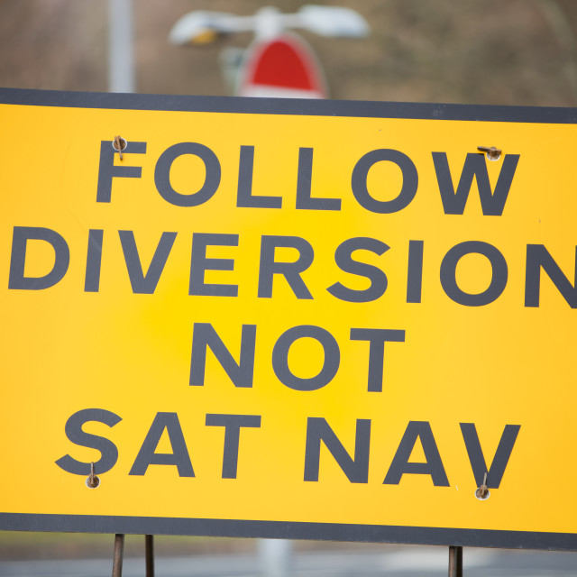"""""""A road sign for a diversion round roadworks in Ambleside, Cumbria, UK,"""" stock image"""