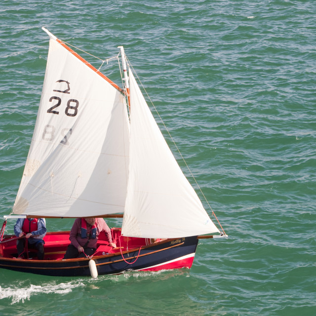 """""""A couple sailing in a small boat off Penzance, Cornwall, UK."""" stock image"""