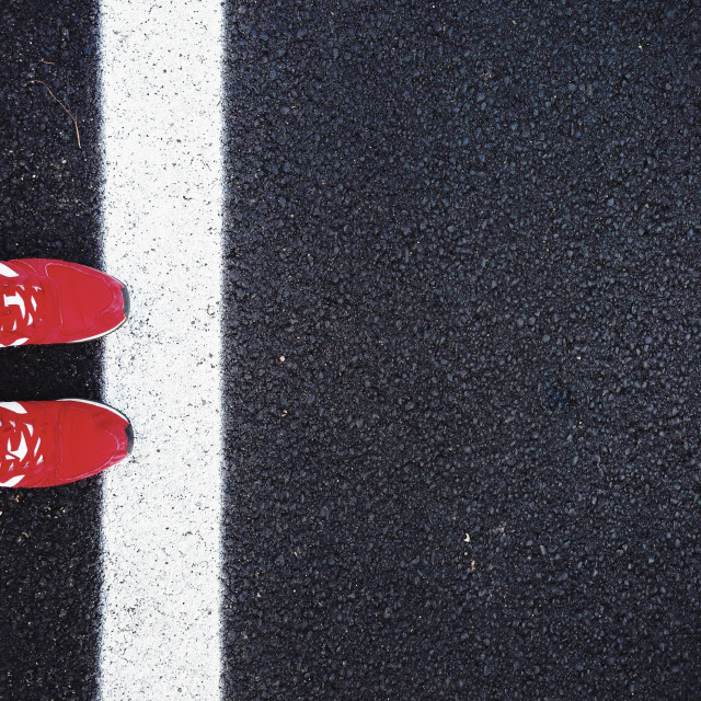 """Red shoes on black asphalt"" stock image"