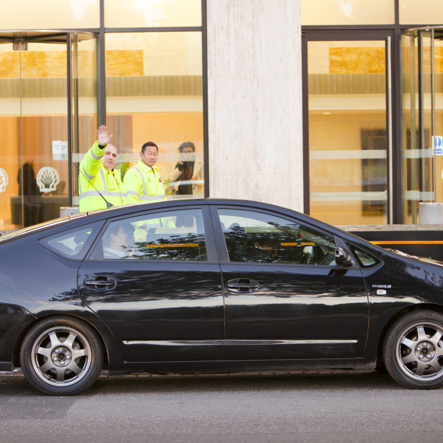 """""""The irony of a Toyota Prius hybrid car parked outside Shell's UK headquarters..."""" stock image"""