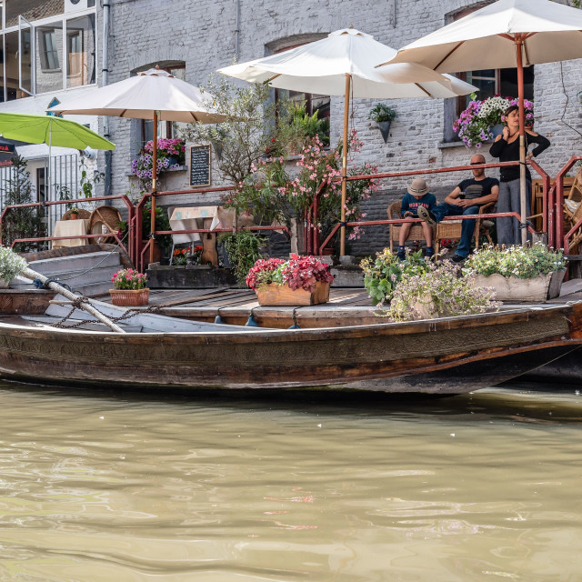 """People sitting on a restaurant terrace ny a canal in the histori"" stock image"
