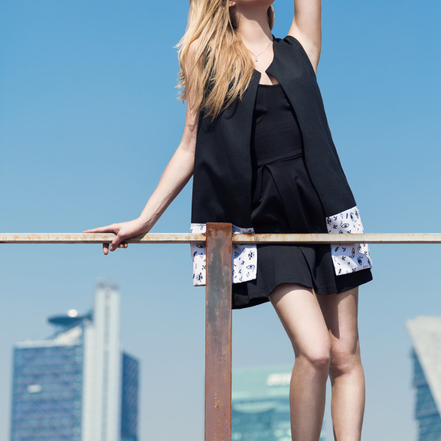 """A blonde fashion model in black clothing in the exterior in a city"" stock image"