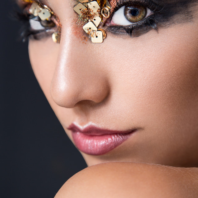 """Head shot of a beauty model with extravagant make up"" stock image"