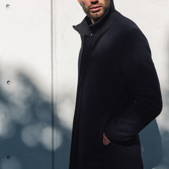 """Male Fashion model in long black coat"" stock image"