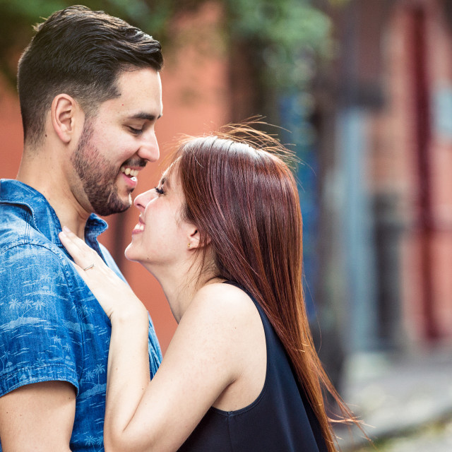 """Couple laughing together in the street"" stock image"