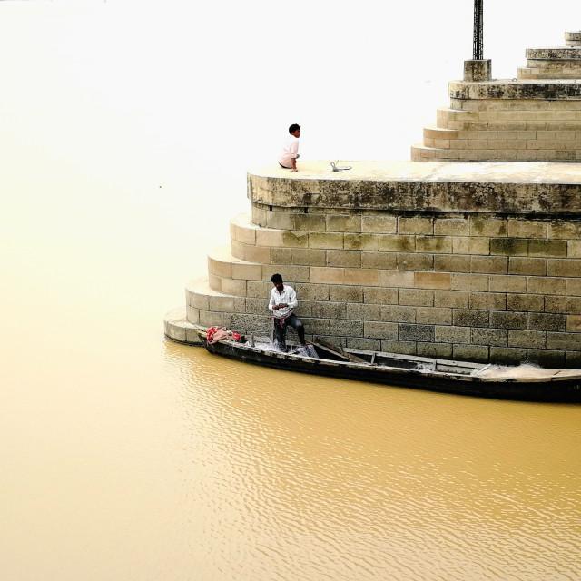 """Man Working on Fishing Net"" stock image"