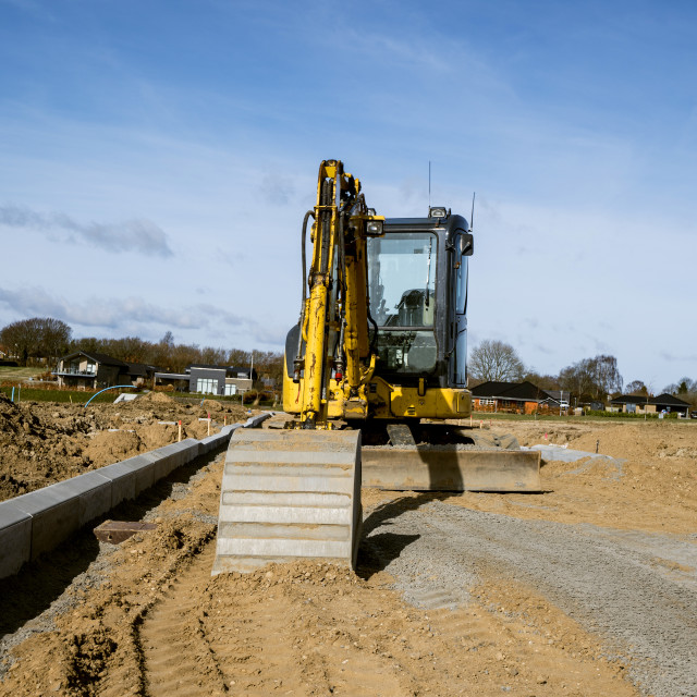 """""""Yellow excavator digging on a construction site"""" stock image"""