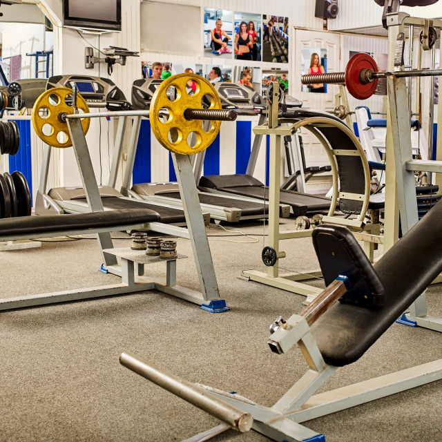 """""""Fitness Room with jogging treadmill and Weight Machines."""" stock image"""