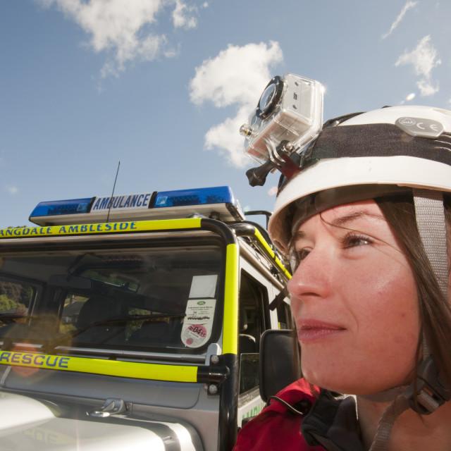 """""""A woman wearing a helmet cam video recorder."""" stock image"""