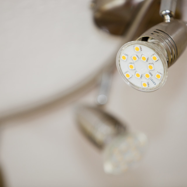 """A light fitting with the latest range of energy saving lights bulbs"" stock image"