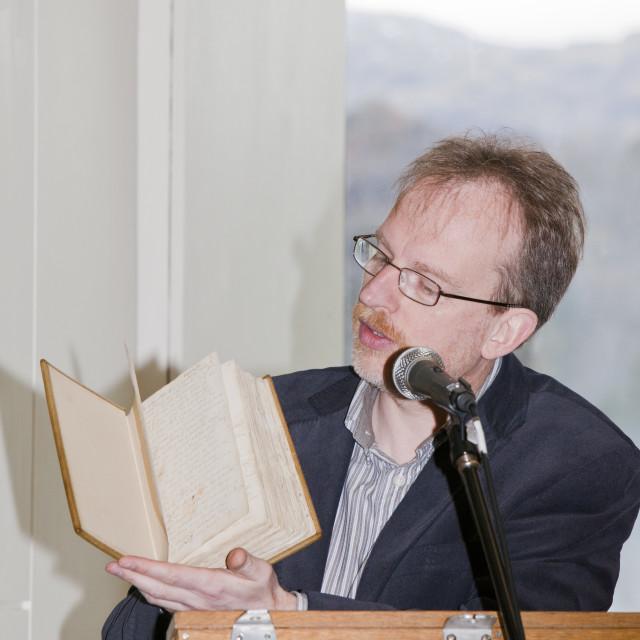 """Jeff Cowton curator of the Wordsworth Trust holding one Wordsworth's original..."" stock image"