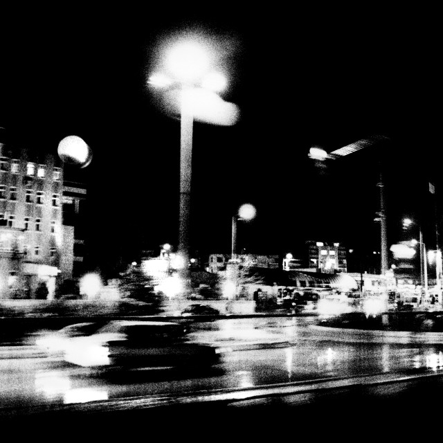 """""""Grainy and murky view of a car speeding through a street at night"""" stock image"""