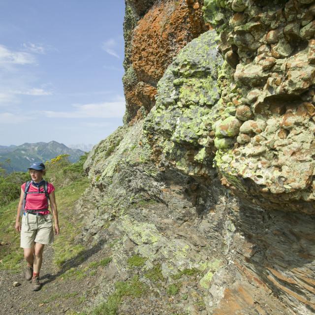 """A woman walking in the Pena de Dobres in the Picos de Europa in spain"" stock image"