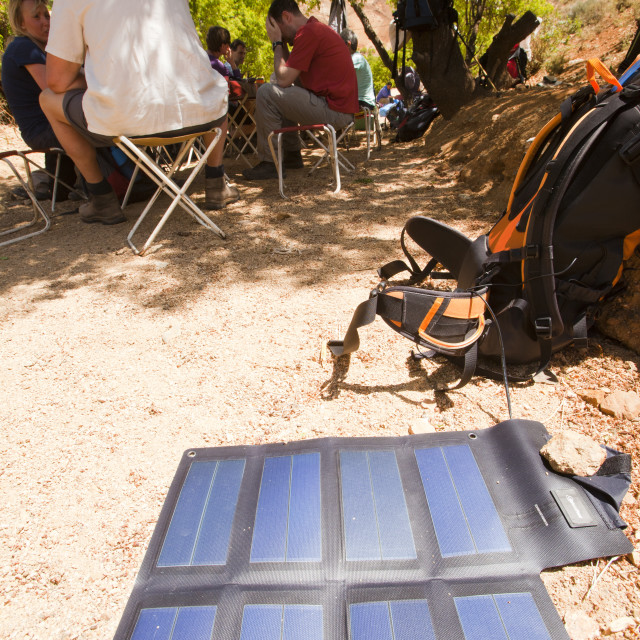 """""""A portable solar mat used fro recharging a mobile phone in the Anti Atlas..."""" stock image"""