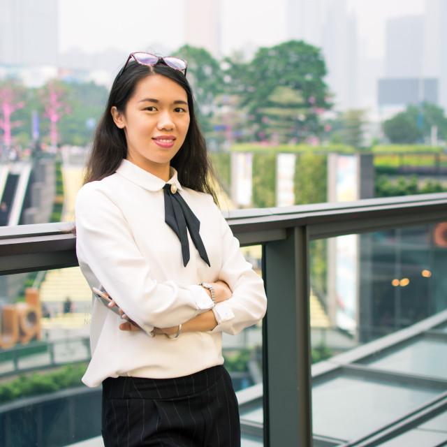 """Confident asian business woman portrait outdoors"" stock image"