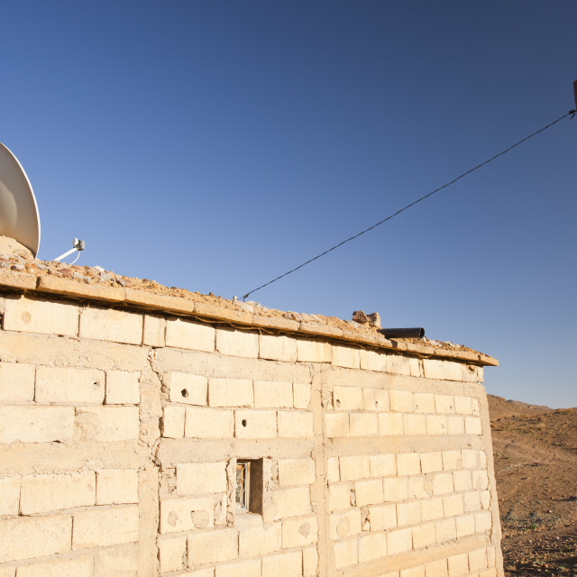 """""""A satelite TV dish on a house in a Berber village near Jebel Sirwa in the..."""" stock image"""