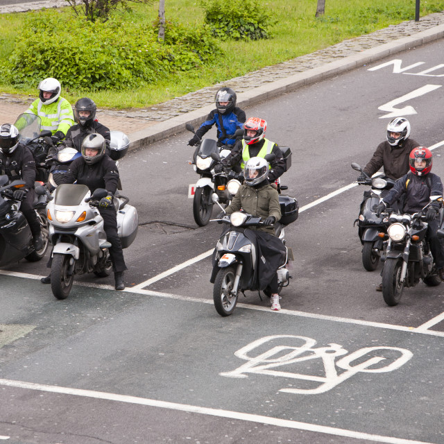 """Motorbikes at a road junction in London, UK."" stock image"