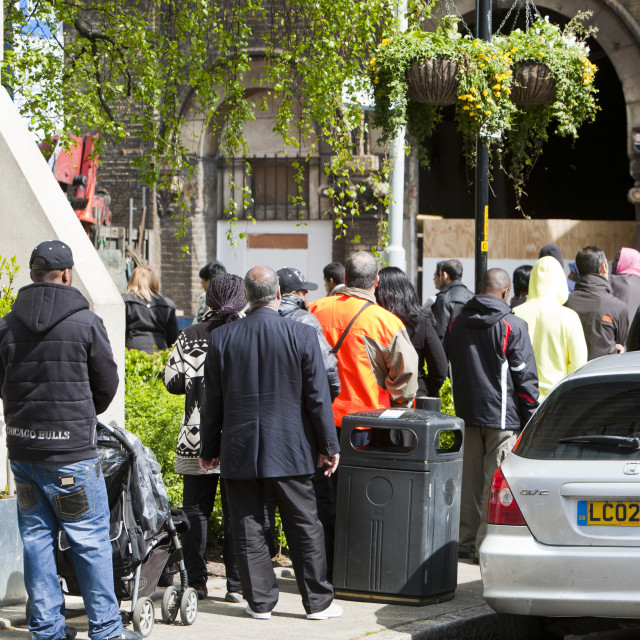 """""""Immigrants queueing up at the UK Border Agency offices in London, UK."""" stock image"""