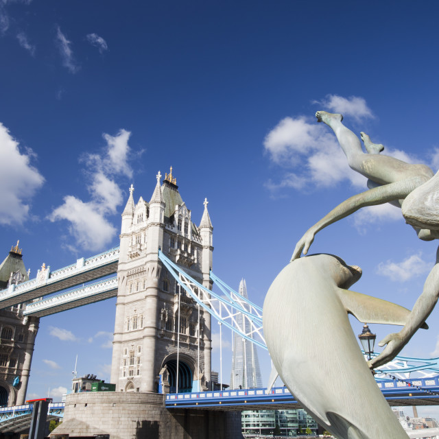 """""""Tower Bridge in London, UK with a dolphin sculpture."""" stock image"""
