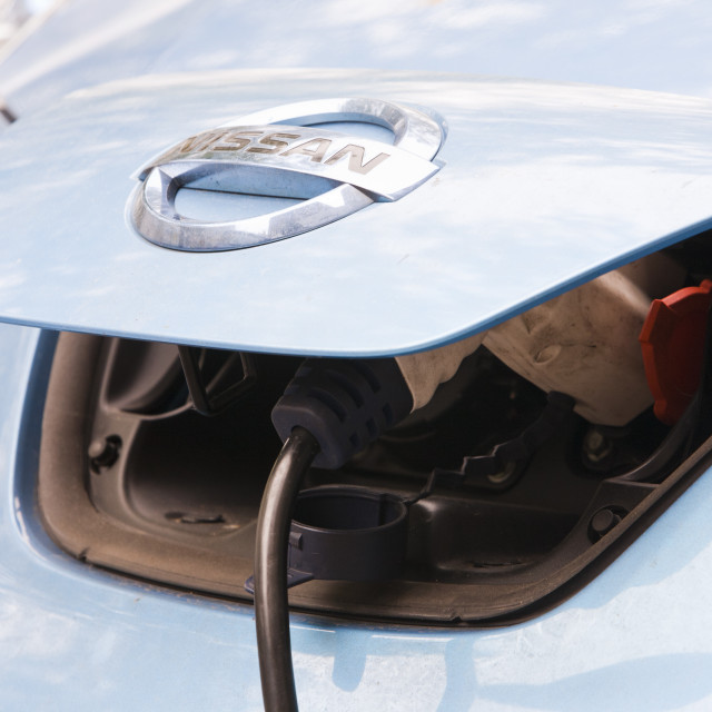 """An electric Nissan Leaf vehicle at a recharging station on the street in..."" stock image"