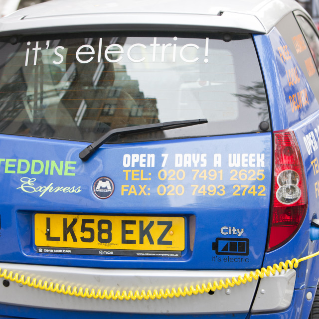 """""""An electric vehicle at a recharging station on the street in Berkeley Square,..."""" stock image"""