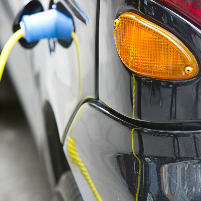 """An electric vehicle at a recharging station on the street in Berkeley Square,..."" stock image"