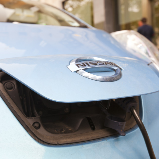 """""""An electric Nissan Leaf vehicle at a recharging station on the street in..."""" stock image"""