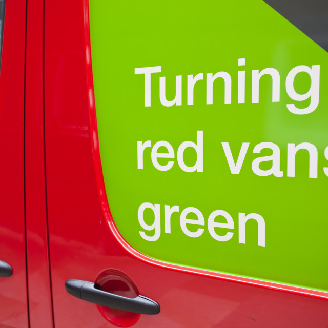 """A Royal Mail van advertising its green credentials, the engine automatically..."" stock image"