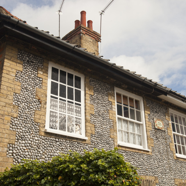 """A window in a house in Holt, Norfolk, UK, that was blocked up due to the..."" stock image"