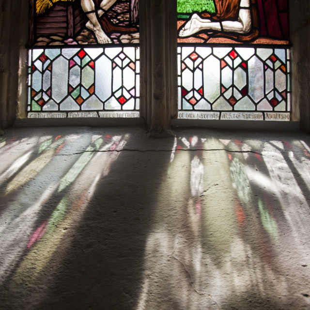 """Stained glass in St Peter and Pauls church in Sustead, Norfolk, UK, is an..."" stock image"