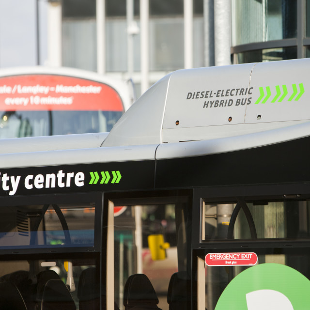 """A hybrid diesel electric shuttle bus that is a free bus service around..."" stock image"