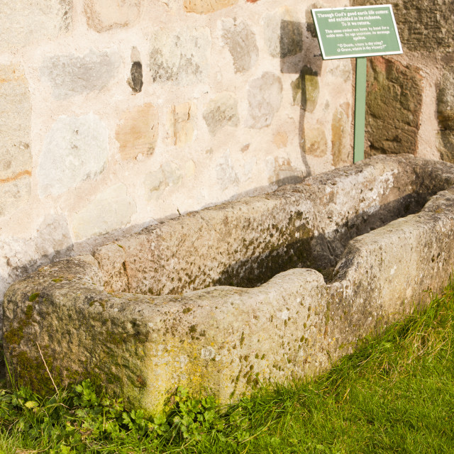 """An ancient stone coffin at St Mary's church in Kirkby Lonsdale, Cumbria, UK."" stock image"