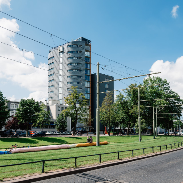 """Rotterdam cityscape with tramway and park"" stock image"