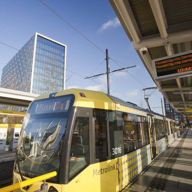"""A tram at Media City , Salford Quays, Manchester, UK."" stock image"