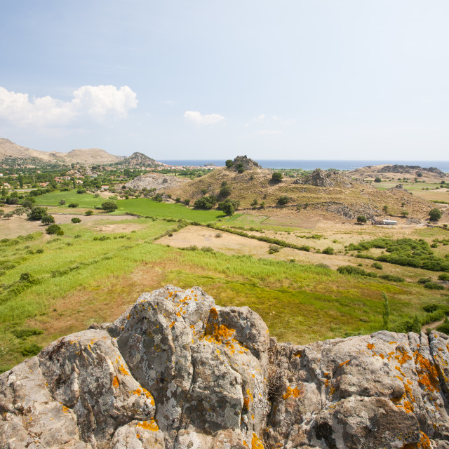 """""""A fertile valley looking green in summer due to irrigation of crops at Skala..."""" stock image"""