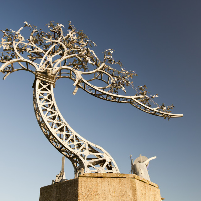 """The Shadows in another light, metal tree sculpture on the banks of the River..."" stock image"