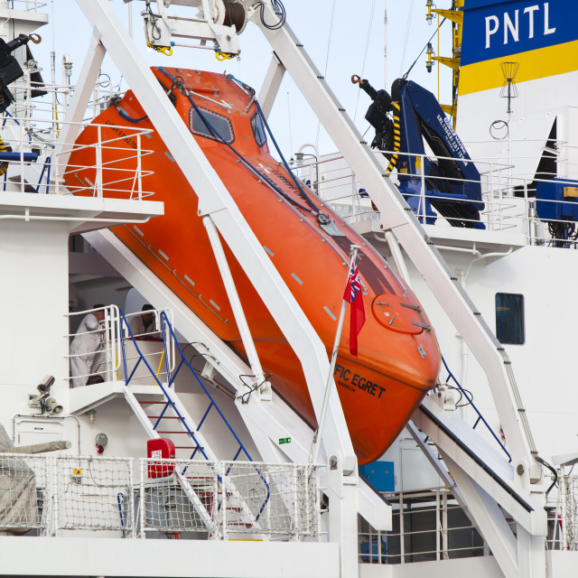 """""""A life boat on a nuclear waste transport vessel in Barrow in Furness docks,..."""" stock image"""