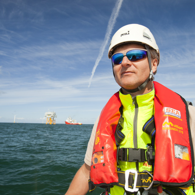 """""""A health and safety inspector on a crew transfer vessel at the Walney..."""" stock image"""