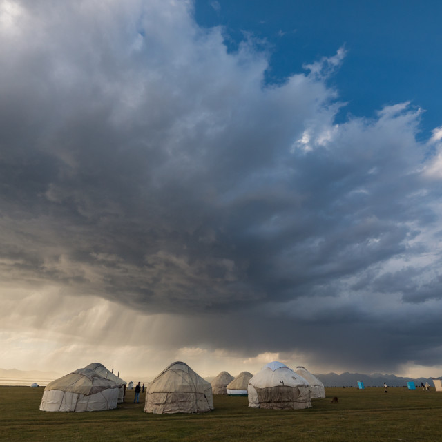 """Rainstorm over a yurt camp"" stock image"