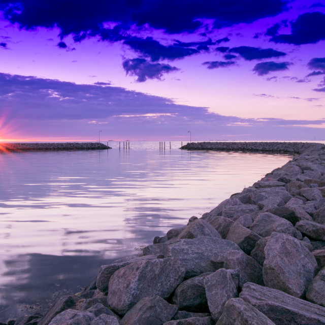 """Rock Jetty at Sunrise"" stock image"