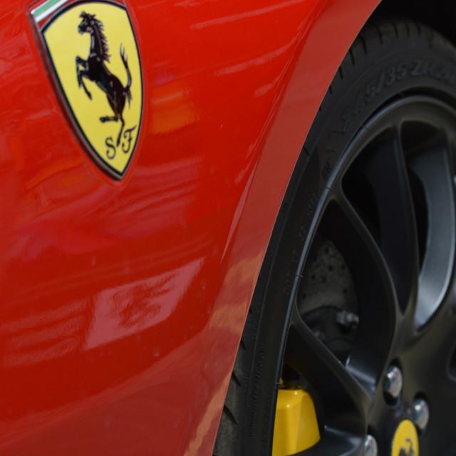"""Ferrari badge on car."" stock image"