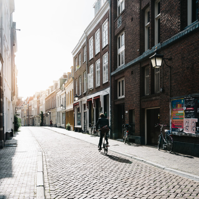 """People and bicycles in street in historic centre of Utrecht, sun"" stock image"