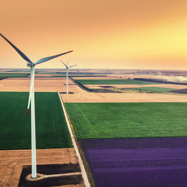 """Sunrise and Wind turbine on a field, aerial view"" stock image"