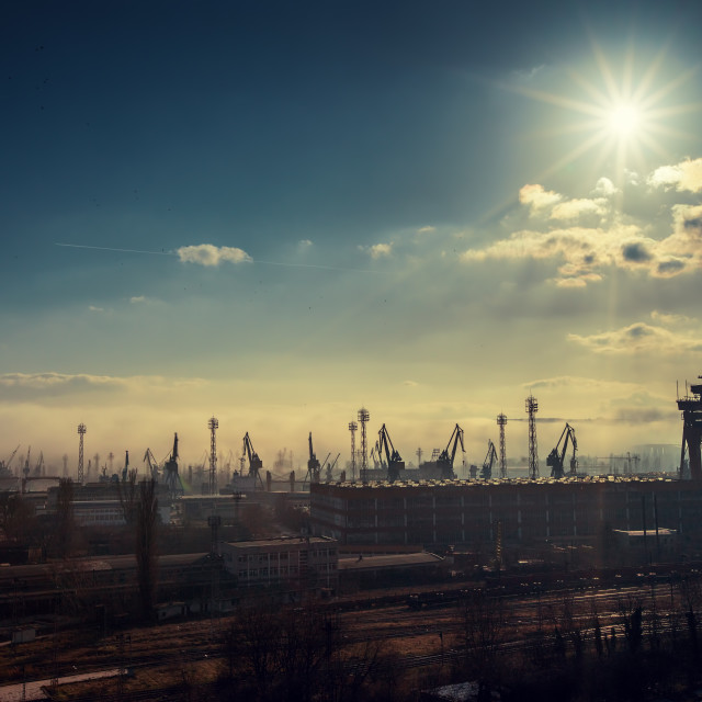 """Panoramic view toward sea port and industrial cranes"" stock image"