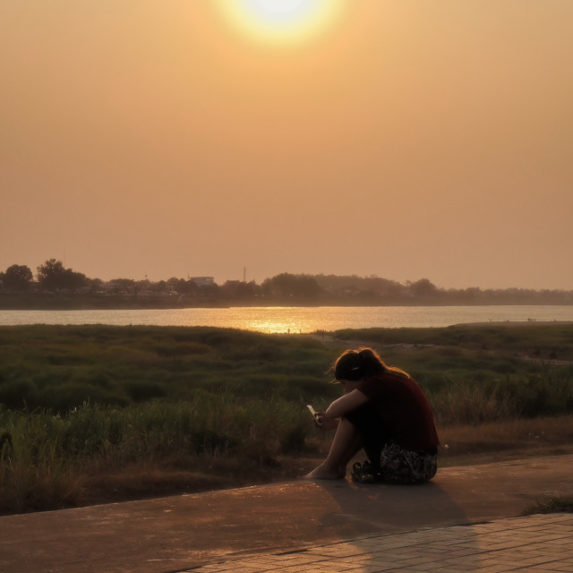 """Modern meditations on the Mekong"" stock image"
